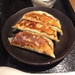 20469882 - 人気の担担麺餃子セット ¥850 の餃子