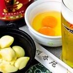 明香苑 - ニンニク鍋(卵付き)