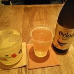 ティダ カジ カフェ - オリオンビールと泡盛マンゴーのソーダ割り