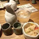 20866853 - 日本酒と生水とお通し