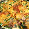 韓館 - 料理写真:『豚キムチチーズチヂミ』石焼皿使用。