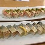 21296068 - 名物 鯖の押し寿司とサーモンの押し寿司