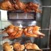 サボロザ - 料理写真:お店の屋台で焼かれるローストチキンです。ジューシーな香りがたまりません!  もも1本:¥400