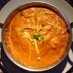 トポリ - 料理写真:第1位 バターチキン トマト、カシューナッツ、スパイスが溶け合った濃厚な美味しさ。
