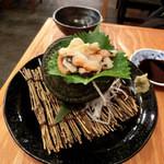 浜焼太郎 - サザエのお刺身。コリコリ♪ サザエのお刺身は初めてだなぁ~o^.^o