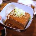 立ち呑み おくどさん - なんだっけ……辛いお豆腐。