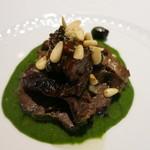 22447284 - 25年11月 野生の鹿背肉の煮込み シチリア産ドライフルーツ、オリーブ添え 黒キャベツのソース