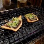 魚正宗 - イカ焼調理中
