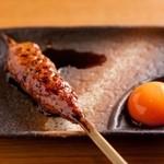 やきとり卯月 - 料理写真:【つくね(卵黄付き)】 「日本一のこだわりの卵」の卵黄を使用。濃厚で新鮮な卵がつくねのたれと絡み合って、抜群の味わいです♪300円