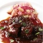 リストランテ厨 - 料理写真:味菜自然豚とプルーンの赤ワイン煮。佐世保の山奥で自然放牧されて育ったこだわりの豚を、じっくりと煮込みました。