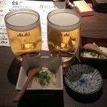 23011518 - 生ビール中とお通しの豆腐