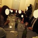 23248156 - 白ワイン4本以上空いてます♪2階での二次会の様子('13.12月)