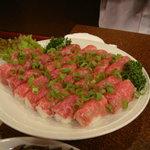 崔安閣 - 牛肉のにぎり