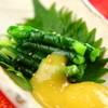 Washinshunsaiakari - 料理写真:からし蓮根に並ぶ郷土料理『一文字ぐるぐる』 熊本では葱を「一文字」と言い、さっと茹で根元を軸に葉の部分を巻きつけ酢味噌につけて食べます。