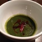 23834558 - 一品目 じゃがいもベースの 高菜のスープ 真ん中の赤いのは豚の燻製