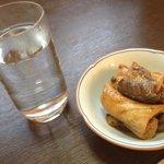 味処みさき - 料理写真:焼酎(いも 湯割)450円。お通しはブリのあら炊きっ♪(第一回投稿分②)