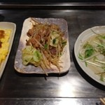 24470575 - 食べてる途中ですいません、左からとんぺい焼、ホルモン炒め、大根とシラスのサラダ