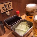 24478921 - もちろん2度つけ禁止のソースとお通しキャベツ&生ビール