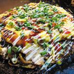 てらまえ - 料理写真:【名物 道頓堀】ふわトロトン平をのせたボリューム満点のモダン焼です。東大阪お好みグランプリ初代金賞商品です。