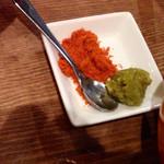 24736427 - 博多もつ鍋~GEKKO風スープ仕立て~(880円)にはカイエンペッパーと柚子胡椒も供されます。正直ほとんど使いませんでしたが、それはスープのだしがうまかったから。でもいい柚子胡椒でしたよ(・∀・)b