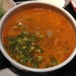 HOI - ランチの担々麺と炒飯(1,000円)炒飯などの付属物はHOIラーメンのセットと同じです。2014年3月