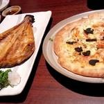 神の斬新 - トリュフのピザ。生地がかなり旨い。想定外の旨さ
