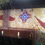 yinega - アーティスト岩切章悟さんの壁画が印象的。