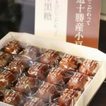 今泉堂 - 看板の『黒糖揚げまんじゅう』