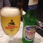 イルチッチォーネ - モレッティのグラスに入った別のビール