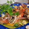トラットリア エ ピッツェリア アミーチ - 料理写真:カサゴのアクアパッツァ
