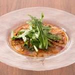 ラ ココリコ - 旬の白身魚のカルパッチョ。ドライトマトとバジルのソース。