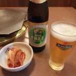 朝日家 - キムチ(ホルモン鍋セット)とキリンフリー