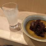 26450304 - 日本酒と蛸の煮物