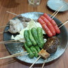 しゅうらく - 料理写真:ちょい飲みセット 980円の串焼き2人分 ※1本食べたあとです。