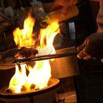 つく根 - 料理写真:マスター、炭火と戦ってます