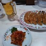 27121625 - 生ビール(飲みかけ失礼)、餃子2人前、キムチ(食べかけ失礼)