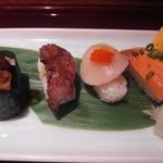 27243200 - <再訪>焼き寿司。フォアグラは臭みがあり、酢飯との相性は× 牛とろも焼きすぎで固いし・・・。