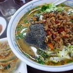 27442014 - 「黒胡麻坦々刀削麺 (880円)」と「ニラと玉子と豚挽肉 (380円)」