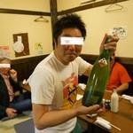 27698003 -  岩手へ戻る彼への歓送迎会・・手に持っているのは、ひろしです・・・。様が熊本から取り寄せたというマムシ酒。結構な値段がします・・(;´∀`)
