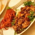 「王朝の味覚」(ディナー11,818円・サービス料別途)のロブスターの黒豆ソース煮。2014年5月