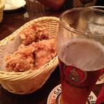 27826047 - 揚げたて唐揚げと大使館ビール(^_^)
