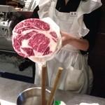 27913303 - スライサーで切る前のお肉