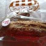 ポポロ - くるみとすぐりのライ麦パン(小)100円(外税)