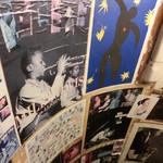 28497133 - お店への階段の壁に貼られたポスター