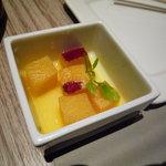 KICHIRI - お通し。さつまいもの角切りをオレンジ風味に煮ています。