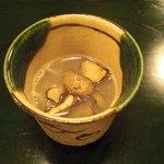 たつむら - 河豚と河豚皮と焼舞茸のスープ。