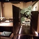 Dining Space FELIZ - 入り口正面に滝があります。