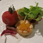 29119260 - ホタテのグリエとトマトのマリネ1400円(3人でとりわけ後)。トマトのマリネがちょうどいい感じで美味しい!
