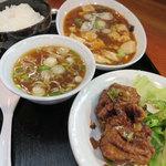 どらごん - ドラゴン定食、麻婆豆腐と唐揚げにライスと中華スープがつきます