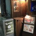 ルミアージュ - 1階の看板、お店は2階